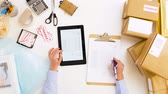 shipping : woman with tablet pc and clipboard at post office Stock Footage