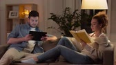 hyggelig : couple with tablet computer and book at home