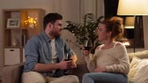 hyggelig : happy couple drinking red wine at home in evening