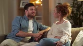 flirty : happy couple talking at home in evening