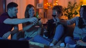 prost : friends with drinks and pizza watching tv at home