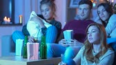 temor : friends with beer and popcorn watching tv at home
