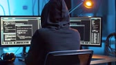 cybercrime : hacker creating computer virus for cyber attack Stock Footage