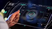 dados : hand holding tablet pc with virtual projections Vídeos
