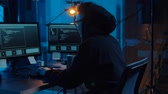 cybercrime : hacker using computer for cyber attack at night Stock Footage