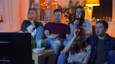 cracker : friends with drinks and snacks watching tv at home Stock Footage