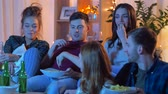 insalubre : friends with drinks and snacks watching tv at home Vídeos