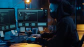 comando : hacker using computer for cyber attack at night Stock Footage