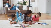 crayon : mother with little daughters drawing at home