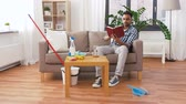 entretien ménager : man reading book and resting after home cleaning