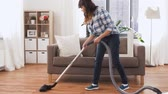 dona de casa : asian woman with vacuum cleaner at home