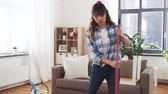 dona de casa : asian woman with broom sweeping floor and cleaning Stock Footage