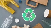 экологический : green recycle symbol with household waste on grey Стоковые видеозаписи