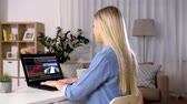 multimediale : woman with video editor program on laptop at home