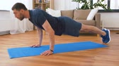 push ups : man doing push ups at home