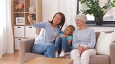 unoka : mother, daughter and grandmother taking selfie