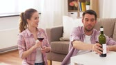 pouring drink : happy couple drinking red wine at home