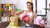 pre teen : daughter with gift box greeting mother on birthday