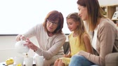 bule : mother, daughter and grandmother having tea party Stock Footage