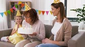 unoka : mother, daughter, grandmother with birthday cake