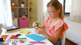 tutkal : creative girl making greeting card at home Stok Video