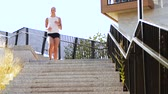 step by step : young woman running downstairs