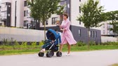 единый : mother with baby in stroller and coffee in city