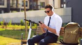 beyaz yaka : businessman with cellphone, headphones and scooter