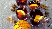 karanfil : hot mulled wine in glasses with orange and spices