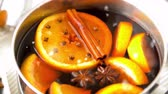 anijs : spices and hot mulled wine with orange slices