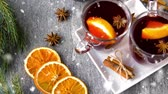 adwent : glasses of hot mulled wine with orange and spices