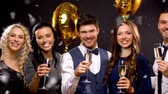 tendo : happy friends with champagne glasses at party Stock Footage