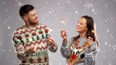 lelijk : happy couple with sparklers at christmas party