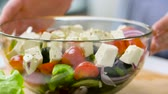 feta : hands turning bowl of vegetable salad with feta Stock Footage