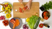 vegetarianism : young woman chopping pepper for salad at home Stock Footage