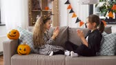 çita : girls in halloween costumes playing game at home