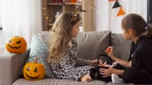 çita : girls in halloween costumes with candies at home