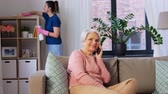 sprzątanie : happy senior woman calling on smartphone at home Wideo