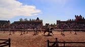 cavaleiro : Close Shot of Two Knights of Horseback Colliding During a Medieval Jousting Tournament