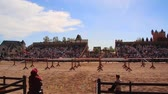 cavaleiro : Wide Shot of Two Armored Knights on Horseback Colliding During a Jousting Tournament