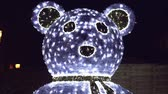 Glowing lights of a White Bear in the night, outside isolated shoot for Christmas event. Стоковые видеозаписи