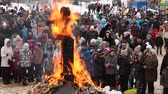 putperest : KOTLAS, RUSSIA - MARCH 2: Remains of burnt effigies of Carnival. The Cossack Carnival - traditional celebration and national ski races around, March 2, 2014 in Kotlas, Russia