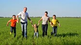 happy : Happy young family with children running around the field