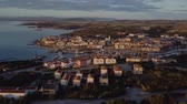 smaragd : Aerial of a pretty village in Sardinia, Italy. Sunrise on the coast, parking yachts, mountains in the background