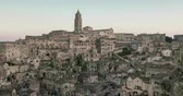 telha : panoramic view of typical stones and church of Matera under sunset sky time lapse, 4K and 1080p Vídeos