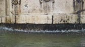 old fountain in Matera with the water falling down and the drops bounce, historical monument and travel