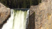 bystřina : Closeup of Lower Falls with people on a viewing platform in Yellowstone National Park, Wyoming, USA