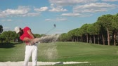 мужской : young healthy golfer hitting golf shot with club on course