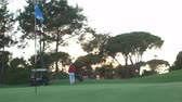 eğitim : golf school, trainer and woman practice golfing shot  on course Stok Video