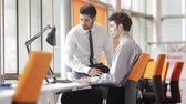 podpis : young couple on business meeting with life insurance and bank loan agent at modern office interior